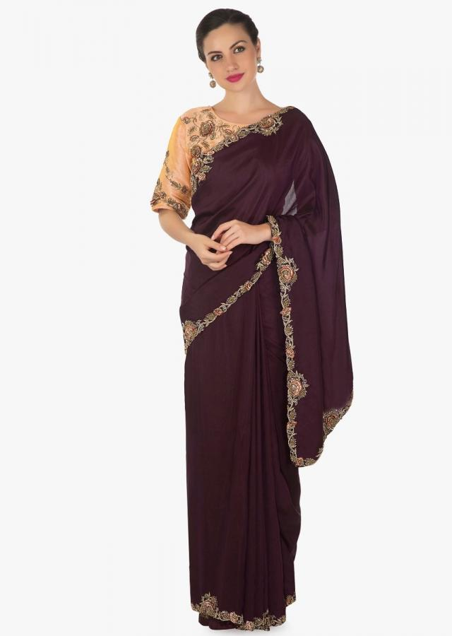 Wine saree in silk with resham and zardosi embroidered border with ready blouse only on Kalki