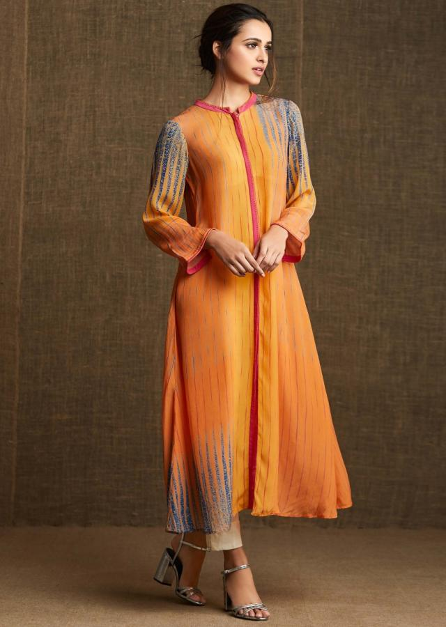 Yellow and orange kurti in pure crepe with contrast pink collar and piping