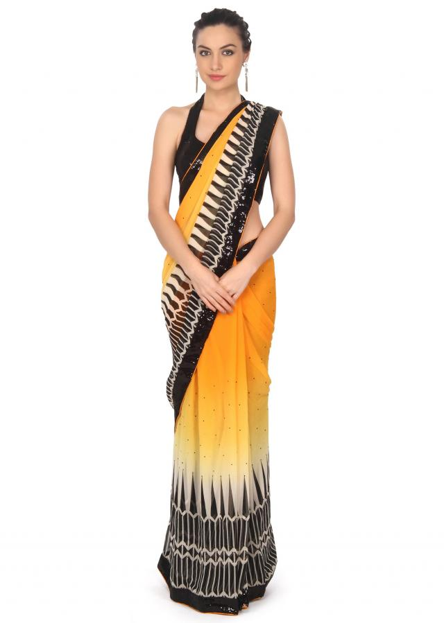 Yellow shaded saree enhanced in print and sequin only on Kalki