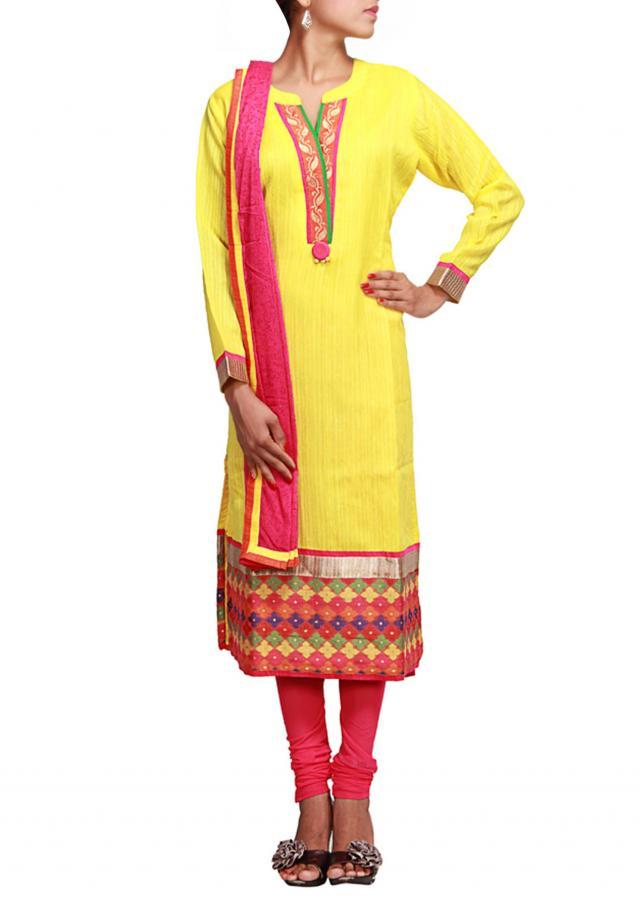 Yellow straight fit suit in yellow highlighted in zari  only on Kalki