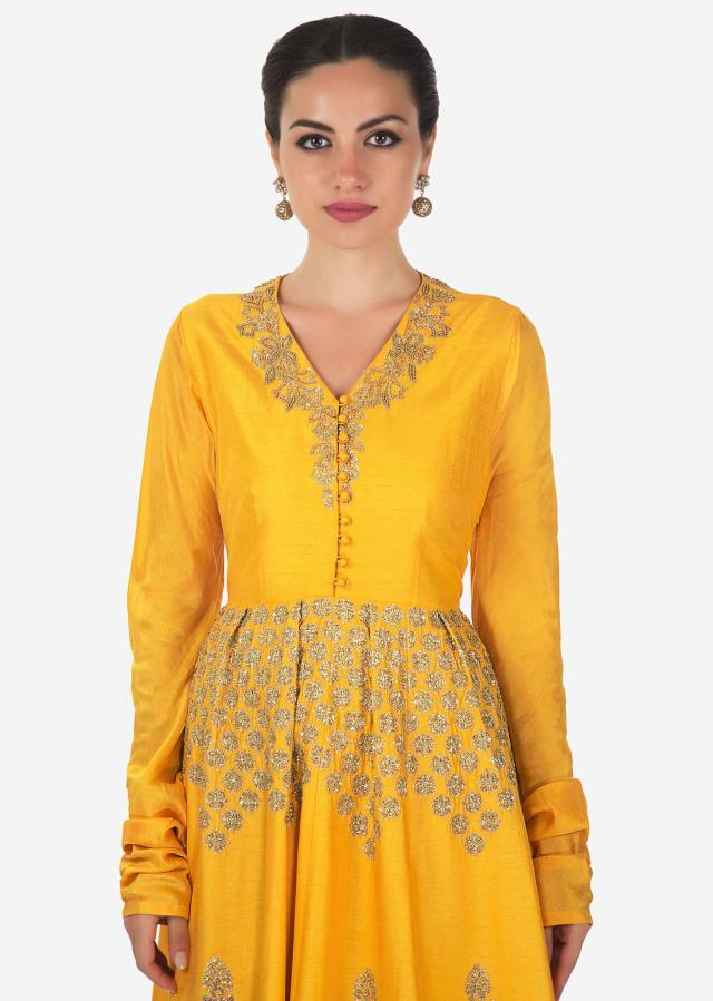 Yellow suit enhanced in pleats and sequin embroidery with dhoti pants only on Kalki