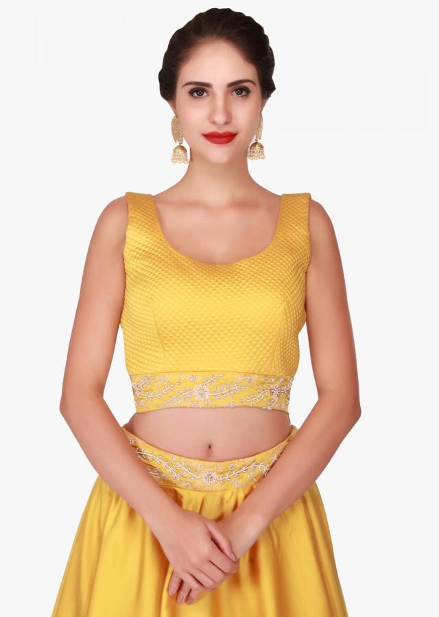 Yellow lehenga with beige jacket featuring the moti and cut dana embroidery work only on Kalki