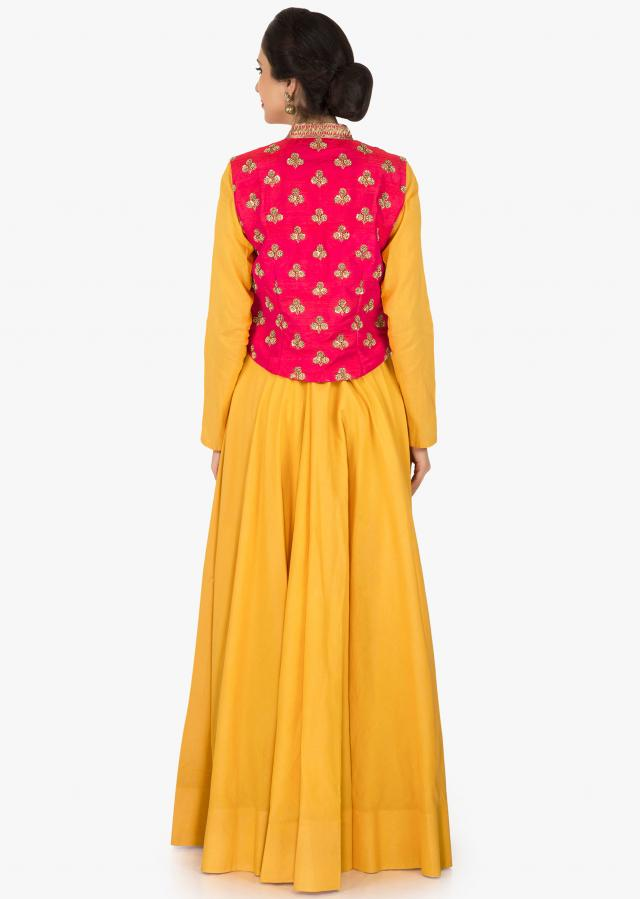 Yellow suit with rani pink jacket enhanced in cutdana and sequin butti work only on Kalki