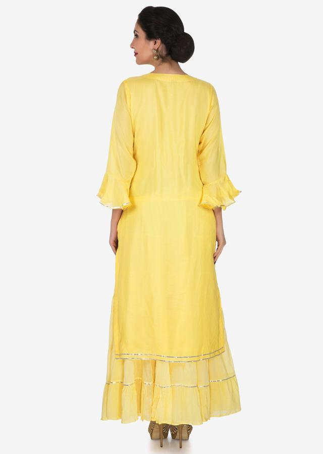 Yellow tunic in cotton with attached skirt adorn in mirror and tassel embroidery work only on Kalki