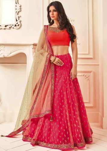 2a2b7df5ab Orange and pink lehenga feautring with zari and embroidered neckline